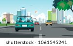 driving in a city with traffic... | Shutterstock .eps vector #1061545241