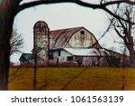 weather beaten old barn   Shutterstock . vector #1061563139
