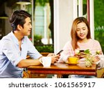 young asian man and woman...   Shutterstock . vector #1061565917