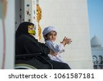 emirates kid with his grand... | Shutterstock . vector #1061587181
