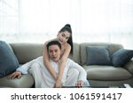 asian couple watch television... | Shutterstock . vector #1061591417