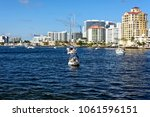 boats and high rise buildings... | Shutterstock . vector #1061596151