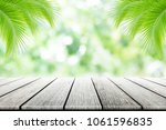 empty wooden table with party... | Shutterstock . vector #1061596835