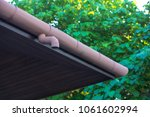 close up on roof guttering... | Shutterstock . vector #1061602994