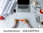top view  architect hands... | Shutterstock . vector #1061609561