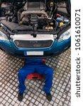 professional mechanic repairing ... | Shutterstock . vector #1061610071