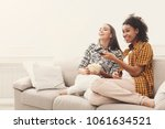 smiling young women relaxing... | Shutterstock . vector #1061634521