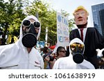 activists wear masks during... | Shutterstock . vector #1061638919