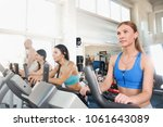 group of four people in the gym ... | Shutterstock . vector #1061643089
