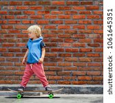little skater on skateboard... | Shutterstock . vector #1061645351
