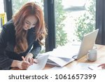 young woman is working in... | Shutterstock . vector #1061657399