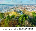 tourists on top of hill. high... | Shutterstock . vector #1061659757