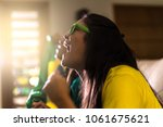 brazilian fan celebrating... | Shutterstock . vector #1061675621