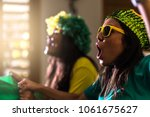 brazilian fan celebrating... | Shutterstock . vector #1061675627