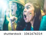 brazilian fan celebrating... | Shutterstock . vector #1061676314