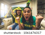Stock photo brazilian fan celebrating during soccer match 1061676317
