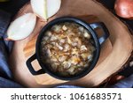fried onion in a frying pan on... | Shutterstock . vector #1061683571