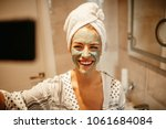 attractive young woman taking a ...   Shutterstock . vector #1061684084
