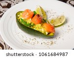 avocado boats stuffed with... | Shutterstock . vector #1061684987