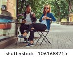 a couple dating drinking coffee ... | Shutterstock . vector #1061688215