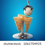 three waffle cones on a metal... | Shutterstock . vector #1061704925