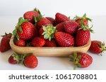 strawberries in the wooden box... | Shutterstock . vector #1061708801