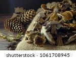dried mushrooms in basket on...   Shutterstock . vector #1061708945