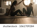 fit man and woman sitting on... | Shutterstock . vector #1061709284