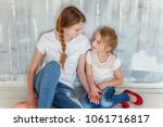 two happy kids sitting against... | Shutterstock . vector #1061716817