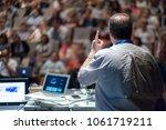 speaker giving a talk on... | Shutterstock . vector #1061719211