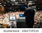 speaker giving a talk on... | Shutterstock . vector #1061719214
