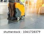 man driving professional floor... | Shutterstock . vector #1061728379