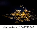 falling gold coins money in... | Shutterstock . vector #1061745047