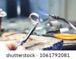 jeweler welding a silver piece... | Shutterstock . vector #1061792081