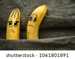 Small photo of Two bananas, husband and wife, on dark sheets. One spouse is offended, the second wants to make up. Family quarrel, quarrel