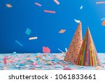 birthday hat and confetti  on... | Shutterstock . vector #1061833661