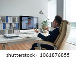 asian entrepreneur talking to... | Shutterstock . vector #1061876855