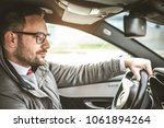 young business man driving car . | Shutterstock . vector #1061894264
