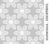white flowers on gray... | Shutterstock .eps vector #1061898041
