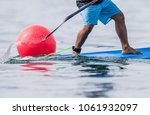 good action on stand up paddle... | Shutterstock . vector #1061932097
