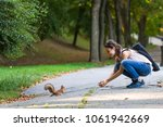 young happy smiling girl in... | Shutterstock . vector #1061942669