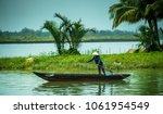 Vietnamese Woman Rowing On...