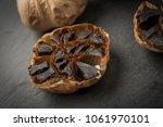 roasted garlic cloves over... | Shutterstock . vector #1061970101