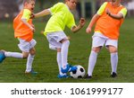 young children players match on ... | Shutterstock . vector #1061999177