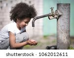 african american child drinking ... | Shutterstock . vector #1062012611