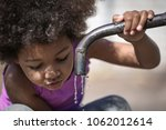 african american child drinking ... | Shutterstock . vector #1062012614