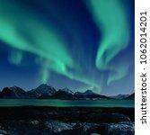 northern lights  aurora... | Shutterstock . vector #1062014201