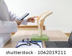 orthopedic surgeons are looking ... | Shutterstock . vector #1062019211