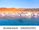 salt on the shore of the dead... | Shutterstock . vector #1062022331