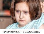 the mother beats her daughter... | Shutterstock . vector #1062033887